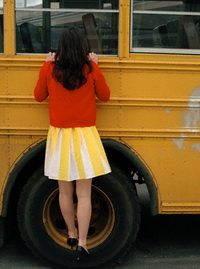 Woman Looking into School Bus